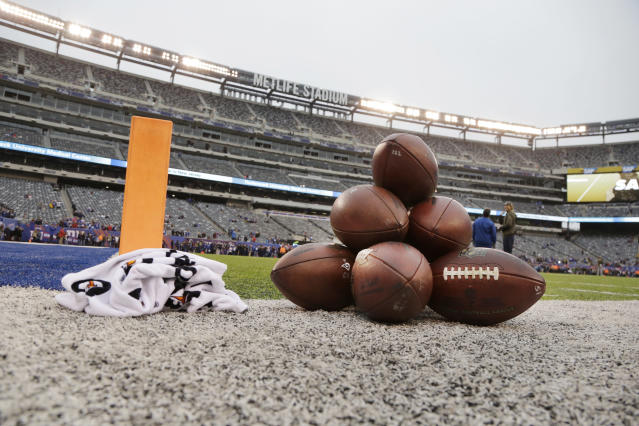 """Footballs are placed on the field before an NFL football game between the <a class=""""link rapid-noclick-resp"""" href=""""/nfl/teams/nyg/"""" data-ylk=""""slk:New York Giants"""">New York Giants</a> and the Los Angeles Rams Sunday, Nov. 5, 2017, in East Rutherford, N.J. (AP Photo/Julio Cortez)"""