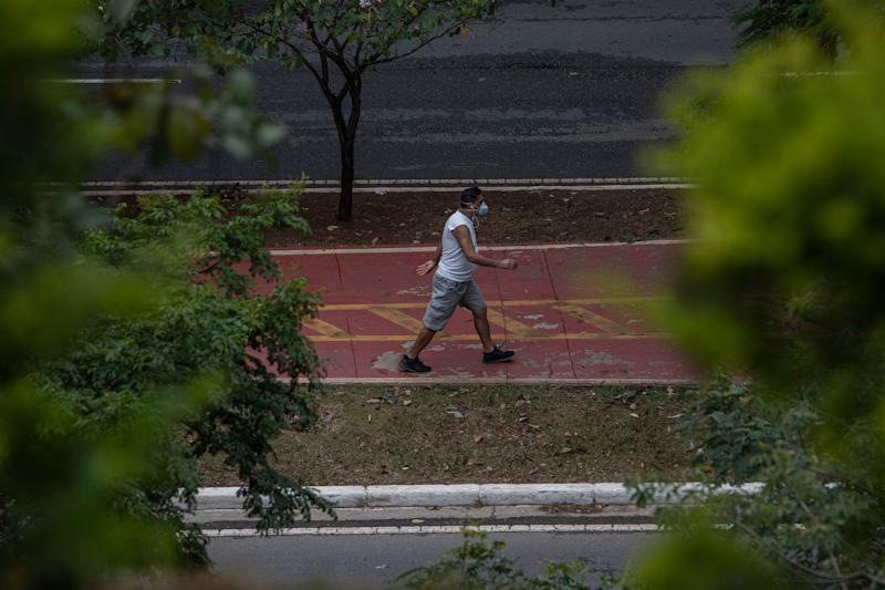 SAO PAULO, BRAZIL - MAY 07: A man walks through the city streets wearing a face mask on May 7, 2020 in Sao Paulo, Brazil. The Government of the State of São Paulo has decreed the mandatory use of face masks in the streets. (Photo by Victor Moriyama/Getty Images)