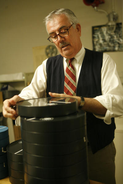 This undated publicity photo released by the Library of Congress shows Patrick Loughney, chief of the Packard Campus of the National Audio-Visual Conservation Center, reviewing films to be preserved at the Library of Congress' Conservation Center in Culpeper, Virginia. (AP Photo/Library of Congress, Abby Brack Lewis)