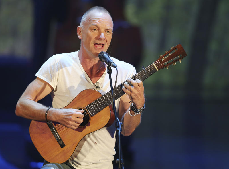 """FILE - This Nov. 10, 2013 file photo shows British singer Sting performing during the Italian State RAI TV program """"Che Tempo che Fa"""", in Milan, Italy. Producers said Wednesday, Feb. 12, 2014, that the show """"The Last Ship,"""" inspired by Sting's memories of growing up in a shipbuilding community in northeast England, will start performances Sept. 30 at the Neil Simon Theatre. Opening night will be Oct. 26. (AP Photo/Antonio Calanni, File)"""