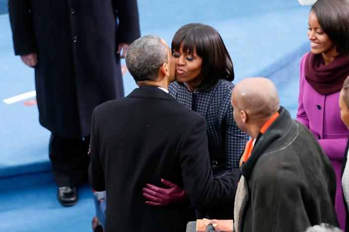 U.S. President Barack Obama kisses First lady Michelle Obama during the presidential inauguration on the West Front of the U.S. Capitol January 21, 2013 in Washington, DC. Barack Obama was re-elected for a second term as President of the United States. (Photo by Rob Carr/Getty Images)
