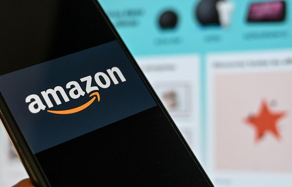 <p>Amazon announces additional holiday bonuses for frontline employees</p> (AFP via Getty Images)