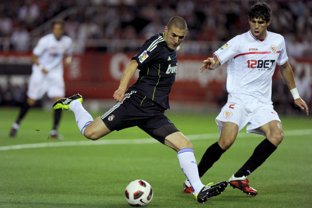 Real Madrid's French forward Karim Benzema (L) vies with Sevilla's Argentinian defender Federico Fazio (R) during the Spanish league football match Sevilla FC vs Real Madrid on May 7, 2011 at the Ramon Sanchez Pizjuan stadium in Sevilla. AFP PHOTO / JORGE GUERRERO (Photo credit should read Jorge Guerrero/AFP/Getty Images)
