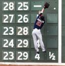 Minnesota Twins left fielder Shane Robinson leaps but can't make the catch on a double by Boston Red Sox designated hitter David Ortiz during the third inning in the first baseball game of a doubleheader at Fenway Park in Boston, Wednesday, June 3, 2015. (AP Photo/Charles Krupa)