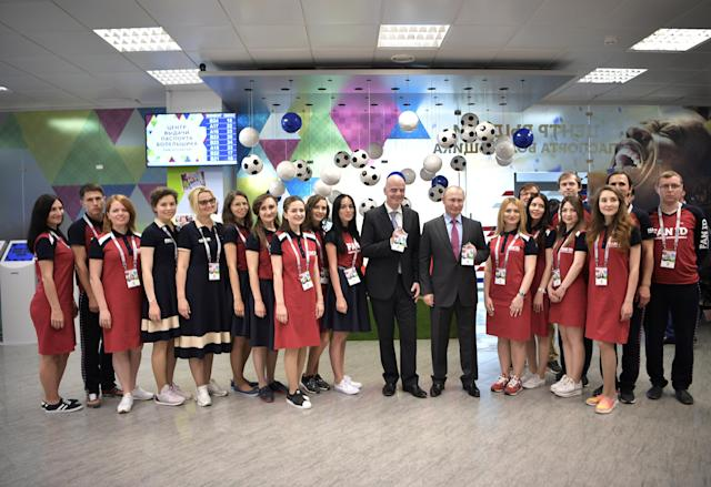 Russian President Vladimir Putin (5th R, 1st row) and FIFA President Gianni Infantino (6th R, 1st row) pose for a picture as they visit a 2018 FIFA World Cup FAN ID distribution centre in Sochi, Russia May 3, 2018. Sputnik/Aleksey Nikolskyi/Kremlin via REUTERS ATTENTION EDITORS - THIS IMAGE WAS PROVIDED BY A THIRD PARTY.