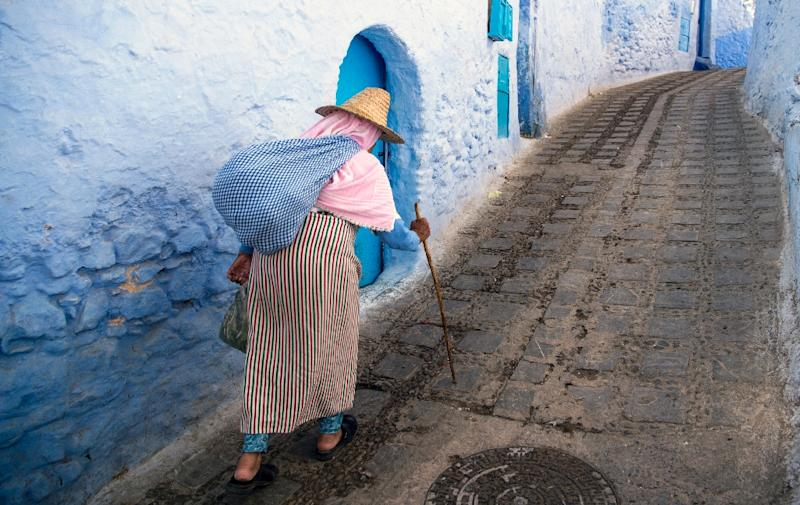 A woman walks in the medina of the northwestern Moroccan city of Chefchaouen (AFP Photo/FADEL SENNA)