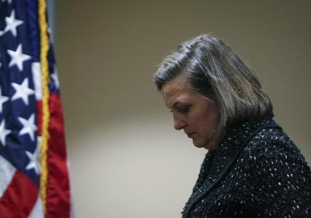"""U.S. Assistant Secretary of State Victoria Nuland leaves after a news conference at the U.S. embassy in Kiev February 7, 2014. U.S. Diplomat Nuland, whose telephone conversation about the political crisis in Ukraine was leaked on the Internet, said on Friday that the recording was """"pretty impressive tradecraft"""" but suggested the leak would not harm her ties with the Ukrainian opposition. REUTERS/Gleb Garanich (UKRAINE - Tags: POLITICS CIVIL UNREST)"""