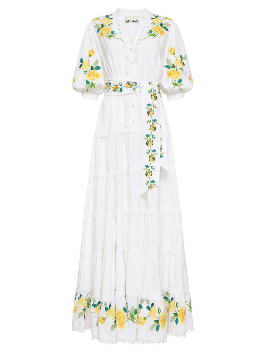 """<h2>Cottagecore</h2><br><br>""""Over the past year, we have all enjoyed spending time in nature and exploring the great outdoors. We see this continuing and reflecting in the way we dress this summer — romantic dresses in soft fabrications, rubber boots, and clogs are the perfect pieces for picnics in the park or staycations outside of the city. """"<br><br>- Liane Wiggins, Head of Womenswear at MATCHESFASHION <br><br><strong>Alemais</strong> Rosa Floral-Embroidered Midi Dress, $, available at <a href=""""https://go.skimresources.com/?id=30283X879131&url=https%3A%2F%2Fwww.matchesfashion.com%2Fus%2Fproducts%2FALE%25CC%2581MAIS-Rosa-floral-embroidered-midi-dress-1432328"""" rel=""""nofollow noopener"""" target=""""_blank"""" data-ylk=""""slk:MatchesFashion"""" class=""""link rapid-noclick-resp"""">MatchesFashion</a>"""