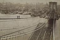 """<p>It may have taken 14 years to build, but when the Brooklyn Bridge opened in 1883 to connect Manhattan and Brooklyn, the single span of 1,595 feet suspended by four cables was a world's first. The 15.5-inch diameter cables comprised of 5,434 parallel galvanized steel wires <a href=""""https://www.asce.org/project/brooklyn-bridge/"""" rel=""""nofollow noopener"""" target=""""_blank"""" data-ylk=""""slk:represented the first time steel was used"""" class=""""link rapid-noclick-resp"""">represented the first time steel was used</a> in a suspension bridge scenario. The towers, built of <a href=""""https://www.britannica.com/topic/Brooklyn-Bridge"""" rel=""""nofollow noopener"""" target=""""_blank"""" data-ylk=""""slk:limestone, granite, and cement"""" class=""""link rapid-noclick-resp"""">limestone, granite, and cement</a>, stand iconic, while the bridge itself used steel—instead of iron—to reduce dead weight.</p>"""