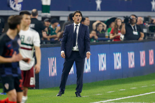 FILE - In this photo taken on Tuesday, March 27, 2018, Croatia head coach Zlatko Dalic watches play during the second half of an international friendly soccer match against Mexico in Arlington, Texas. (AP Photo/Roger Steinman)