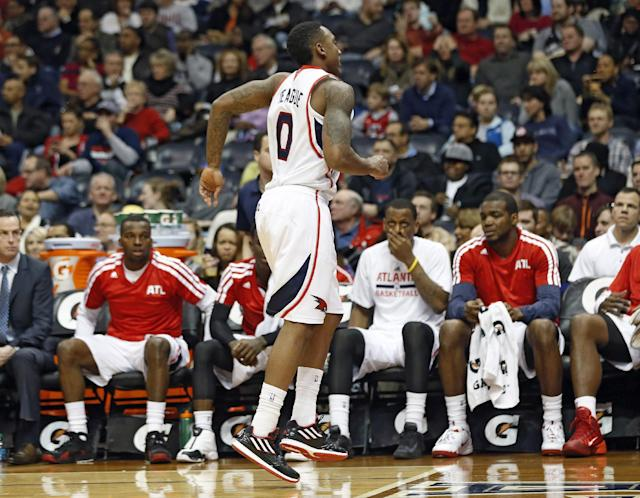Atlanta Hawks point guard Jeff Teague (0) limps off the court after being injured in the first half of an NBA basketball game against the San Antonio Spurs Friday, Jan. 24, 2014, in Atlanta. (AP Photo/John Bazemore)