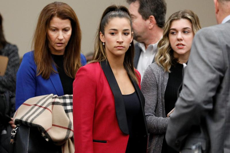 Olympic gold medalist Aly Raisman appears before speaking at the sentencing hearing for Larry Nassar, a former team USA Gymnastics doctor who pleaded guilty in November to sexual assault charges. Nassar has been sentenced to up to 175 years in prison. (Brendan McDermid / Reuters)