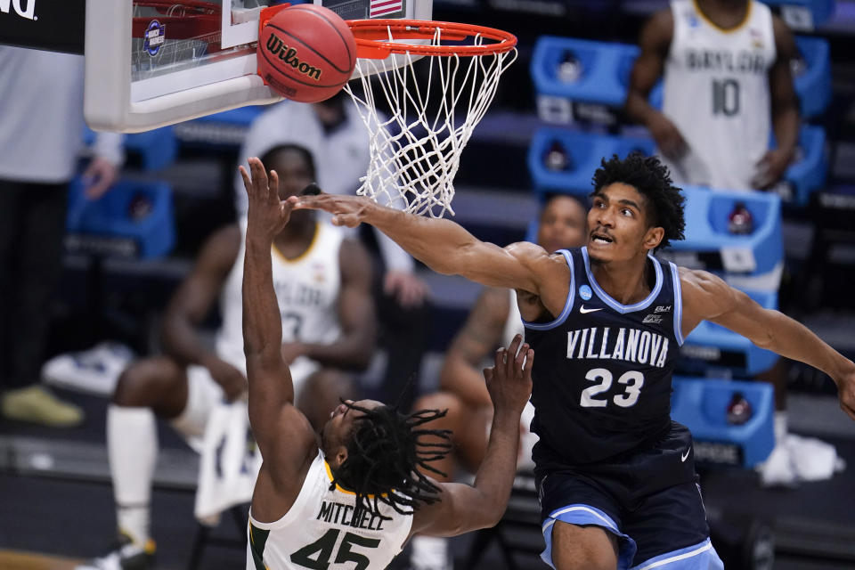 Baylor guard Davion Mitchell (45) shoots on Baylor forward Jonathan Tchamwa Tchatchoua (23) in the second half of a Sweet 16 game in the NCAA men's college basketball tournament at Hinkle Fieldhouse in Indianapolis, Saturday, March 27, 2021. (AP Photo/Michael Conroy)