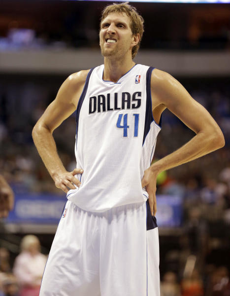 Dallas Mavericks power forward Dirk Nowitzki (41) of Germany grimaces as he stands at the free throw line during the second half of an NBA preseason basketball game against the Orlando Magic in Dallas, Monday, Oct. 14, 2013. The Magic won 102-94. (AP Photo/LM Otero)