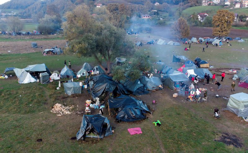 An aerial picture shows Afghan migrants in a makeshift camp near Velika Kladusa