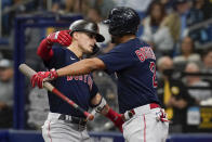 Boston Red Sox's Enrique Hernandez, left, celebrates his solo home run against the Tampa Bay Rayw with Xander Bogaerts (2) during the fifth inning in Game 2 of a baseball American League Division Series, Friday, Oct. 8, 2021, in St. Petersburg, Fla. (AP Photo/Steve Helber)