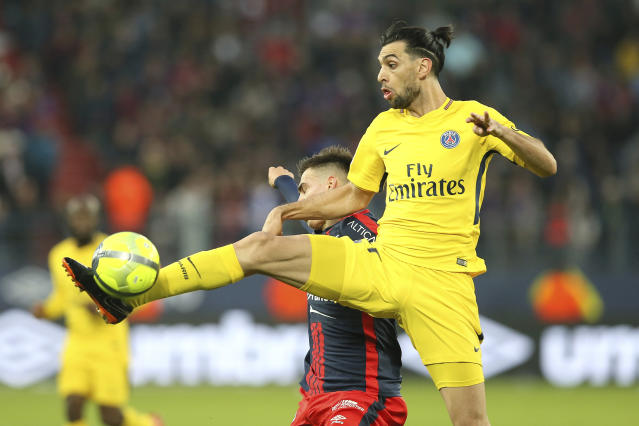 Javier Pastore of Paris Saint Germain controls the ball ahead of Jessy Deminguet of Caen during their League One soccer match at the Michel d'Ornano stadium in Caen, western France, Saturday, May 19, 2018. (AP Photo/David Vincent)