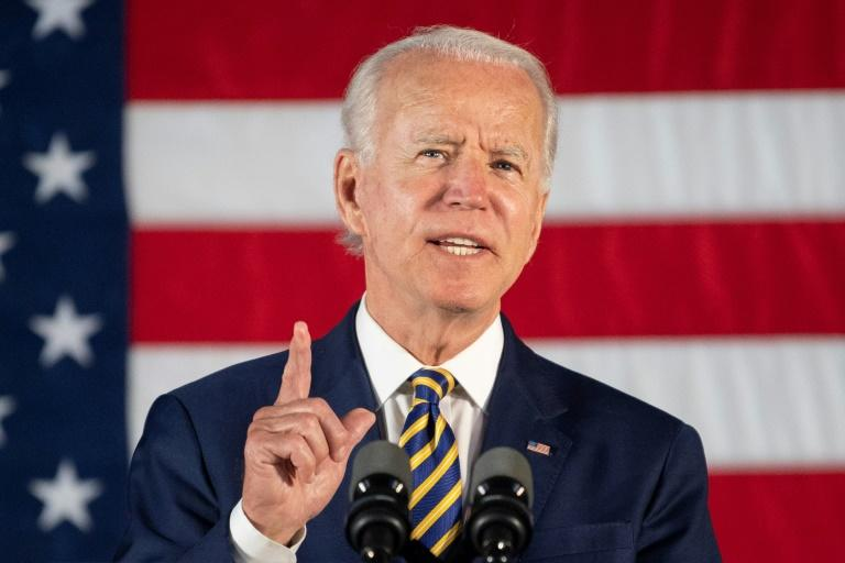 Democratic presidential candidate Joe Biden (pictured June 17, 2020) and the Democratic Party raised nearly $81 million in May 2020 (AFP Photo/JIM WATSON)