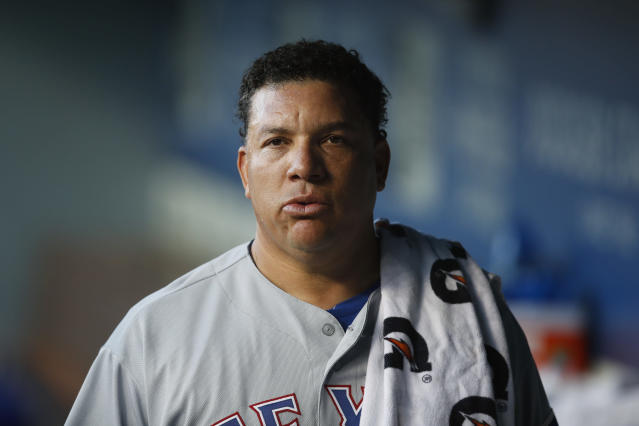 Texas Rangers starting pitcher Bartolo Colon walks through the dugout before the team's baseball game against the Los Angeles Dodgers, Tuesday, June 12, 2018, in Los Angeles. (AP Photo/Jae C. Hong)