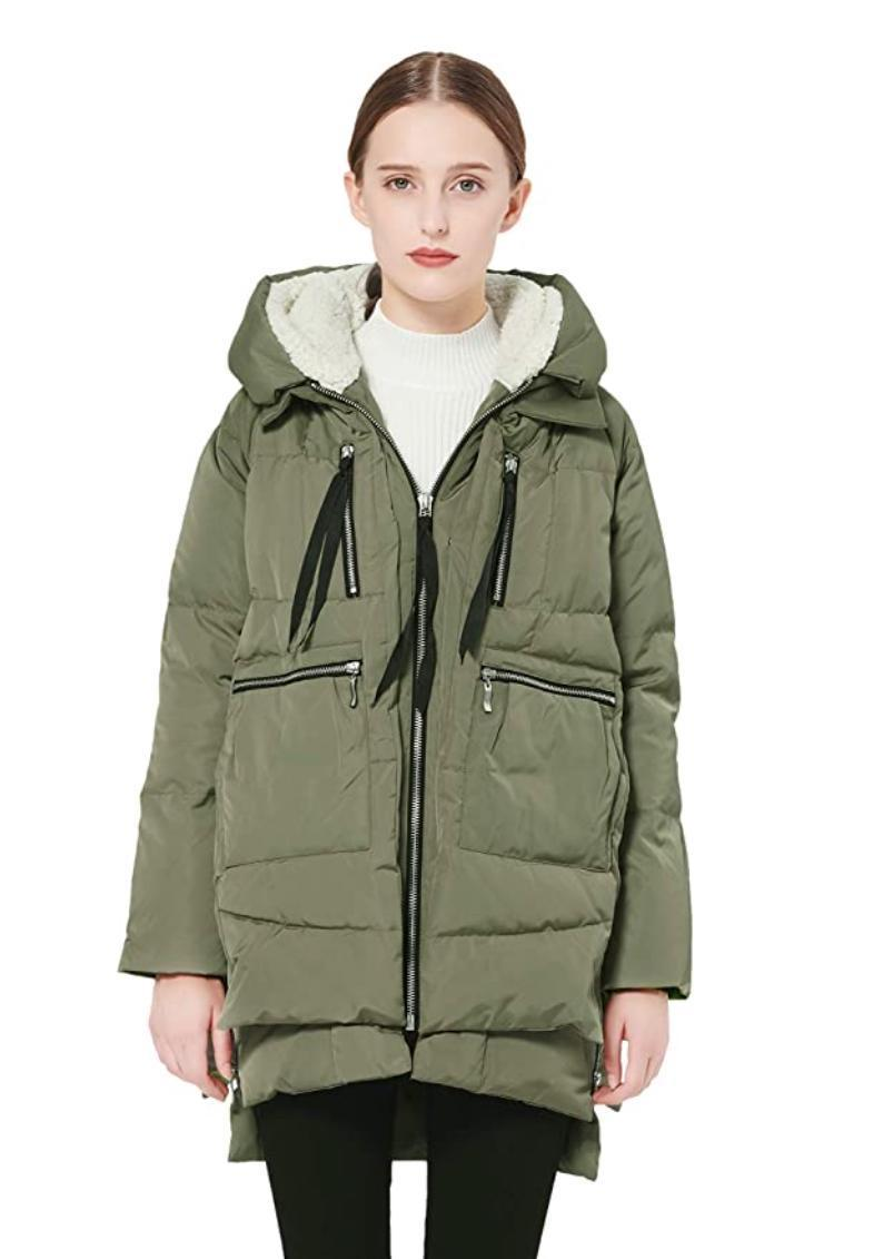 """With over 11,000 reviews, this authentic down jacket is the coat that <a href=""""https://www.glamour.com/story/orolay-jacket-amazon-coat-review?mbid=synd_yahoo_rss"""" rel=""""nofollow noopener"""" target=""""_blank"""" data-ylk=""""slk:started it al"""" class=""""link rapid-noclick-resp"""">started it al</a>l. It's wind-proof and extra warm, making it ideal for wintry nights ahead. Plus, it has six oversize packets so you don't even have to bring your handbag with you to nighttime grocery store runs. $140, Amazon. <a href=""""https://www.amazon.com/Orolay-Womens-Thickened-Jacket-Green/dp/B00HHOLC0O/"""" rel=""""nofollow noopener"""" target=""""_blank"""" data-ylk=""""slk:Get it now!"""" class=""""link rapid-noclick-resp"""">Get it now!</a>"""