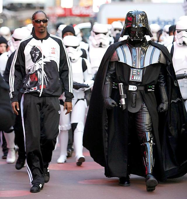 <p>Snoop is the only guy in this galaxy cool enough to hold his own alongside Darth Vader. The rapper was by the evil character's side as they promoted a <em>Star Wars</em> line for Adidas in NYC's Times Square. (Photo by Joe Kohen/WireImage) </p>
