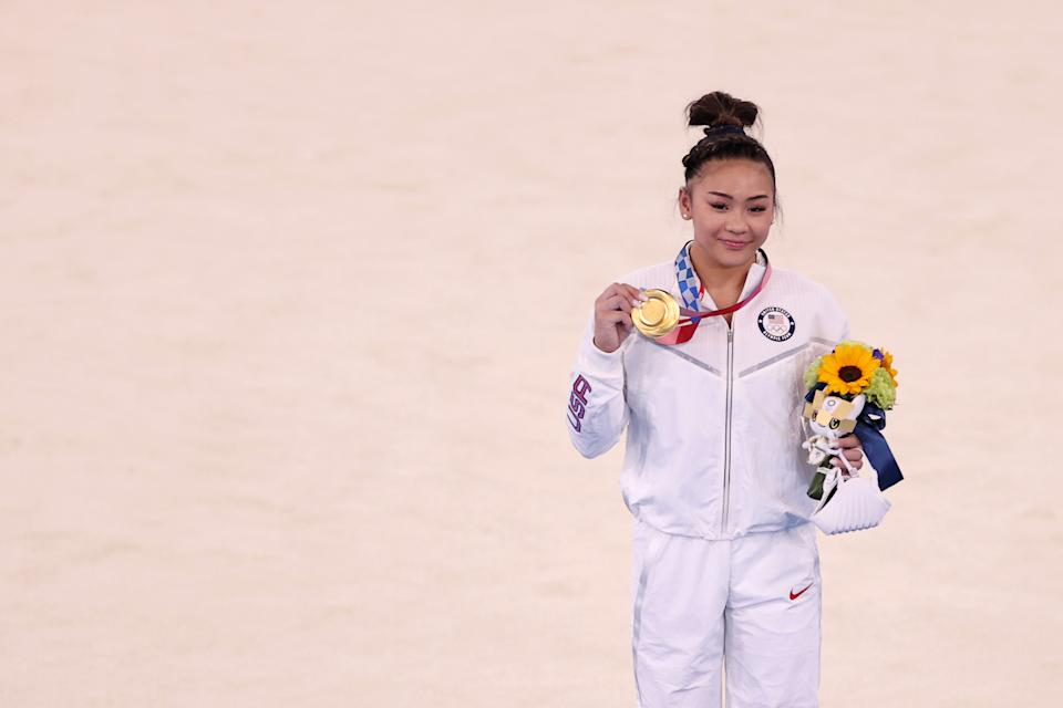TOKYO, JAPAN - JULY 29: Sunisa Lee of Team United States poses with her gold medal after winning the Women's All-Around Final on day six of the Tokyo 2020 Olympic Games at Ariake Gymnastics Centre on July 29, 2021 in Tokyo, Japan. (Photo by Laurence Griffiths/Getty Images)
