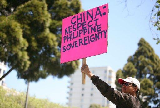 Anti-China protesters gather outside of the Consulate General of China in San Francisco