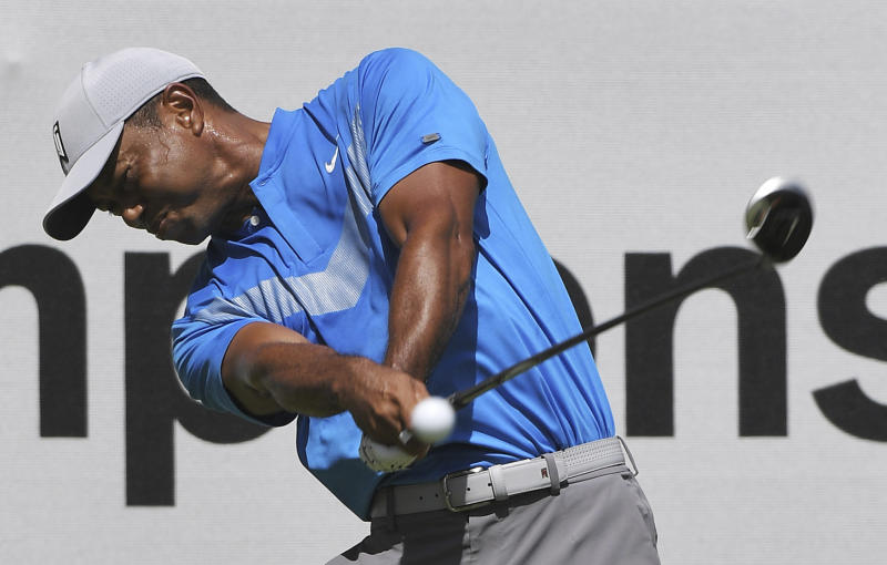 Tiger Woods tees off during the first round of the BMW Championship golf tournament at Medinah Country Club, Thursday, Aug. 15, 2019, in Medinah, Ill. (Joe Lewnard/Daily Herald via AP)