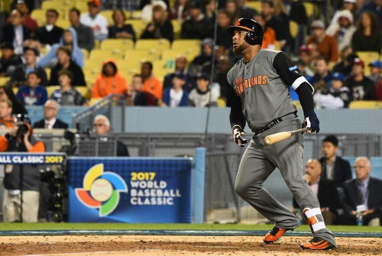 Wladimir Balentien of the Netherlands hits a double in the fifth inning against Puerto Rico during the World Baseball Classic, at Dodger Stadium in Los Angeles, on March 20, 2017