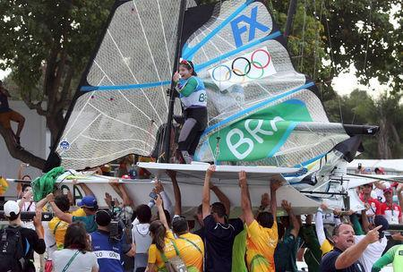 FILE PHOTO: 2016 Rio Olympics - Sailing - Final - Women's Skiff - 49er FX - Medal Race - Marina de Gloria - Rio de Janeiro, Brazil - 18/08/2016. Martine Grael (BRA) of Brazil celebrates winning gold medal. REUTERS/Benoit Tessier/File Photo