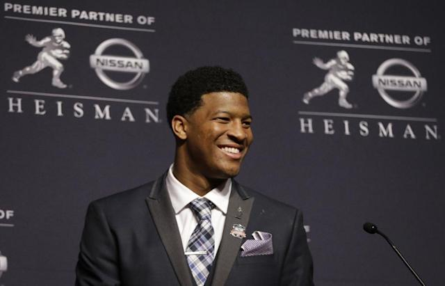 Florida State quarterback Jameis Winston talks to reporters after winning the Heisman Trophy, Saturday, Dec. 14, 2013, in New York. (AP Photo/Julio Cortez)