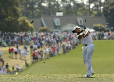 Rory McIlroy of Northern Ireland hits on the first fairway during first round play of the Masters golf tournament at the Augusta National Golf Course in Augusta, Georgia April 9, 2015. REUTERS/Brian Snyder