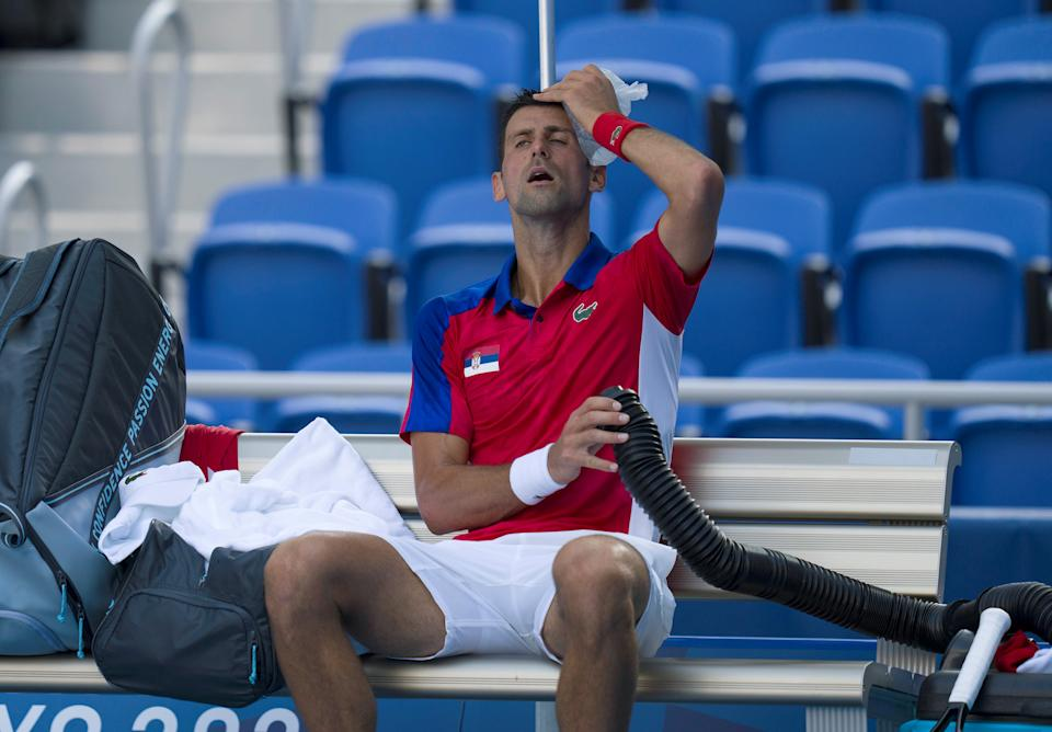 <p>Novak Djokovic of Serbia cools down his body during the tennis men's singles first round match against Hugo Dellien of Bolivia at the Tokyo 2020 Olympic Games in Tokyo, Japan, July 24, 2021. (Photo by Fei Maohua/Xinhua via Getty Images)</p>