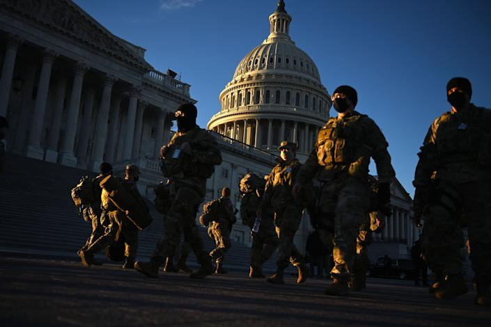 Members of the US National Guard are seen outside the US Capitol on January 19, 2021 in Washington, DC, ahead of the 59th inaugural ceremony for President-elect Joe Biden and Vice President-elect Kamala Harris. (Photo by Brendan SMIALOWSKI / AFP) (Photo by BRENDAN SMIALOWSKI/AFP via Getty Images)