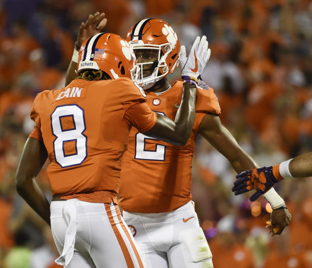 Clemson quarterback Kelly Bryant (2) celebrates with Deon Cain (8) after scoring a touchdown against Auburn during the first half of an NCAA college football game, Saturday, Sept. 9, 2017, in Clemson, S.C. (AP Photo/Rainier Ehrhardt)