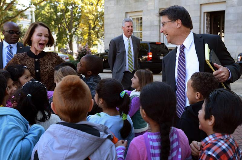 Governor-elect Pat McCrory tells school children from Dillard Elementary School to hug the new first lady, his wife Ann, after their meeting with Gov. Bev Perdue Thursday Nov. 8, 2012, in Raleigh, N.C. McCrory was in Raleigh to set up his transition office, meet with Perdue and hold his first news conference. (AP Photo/The News & Observer, Chuck Liddy)