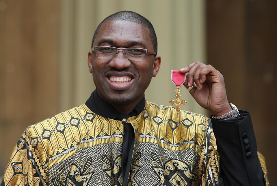 LONDON, UNITED KINGDOM - DECEMBER 13: Playwright and actor Kwame Kwei-Armah holds his Officer of the British Empire (OBE) medal which was awarded to him by Queen Elizabeth II during an Investiture ceremony at Buckingham Palace on December 13, 2012 in London, England. (Photo by Sean Dempsey - WPA Pool/Getty Images)