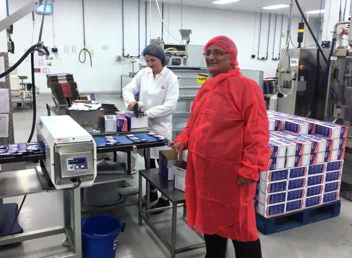 """In this photo taken on Tuesday, Sept. 10, 2019, Kamal Dhutia, managing director of B I Europe Limited, a family-run firm of about 50 workers, is seen in his factory in Loughborough, England. Britain hasn't left the European Union yet, but the tortuous Brexit process is already causing financial problems for B I Europe Limited, a family-run firm in the north of England. The reason is straightforward: Britain is still part of the 28-nation doubt bloc, and enjoys easy trading across its borders, but there have been a series of deadlines for Britain's withdrawal from the bloc that have created uncertainty about whether a """"no-deal"""" Brexit will abruptly bring back borders and tariffs. (AP Photo/Jeff Schaeffer)"""