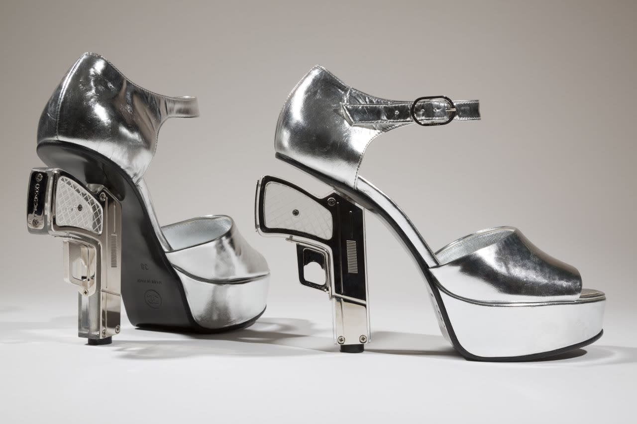 "In this undated photo provided by the Fashion Institute of Technology shows a pair of silver shoes designed by Chanel with guns as heels. The shoe is on display at the ""Shoe Obsession"" exhibit at The Museum at the Fashion Institute of Technology Museum in New York. The exhibition, showing off 153 specimens, runs through April 13. (AP Photo/Fashion Institute of Technology)"