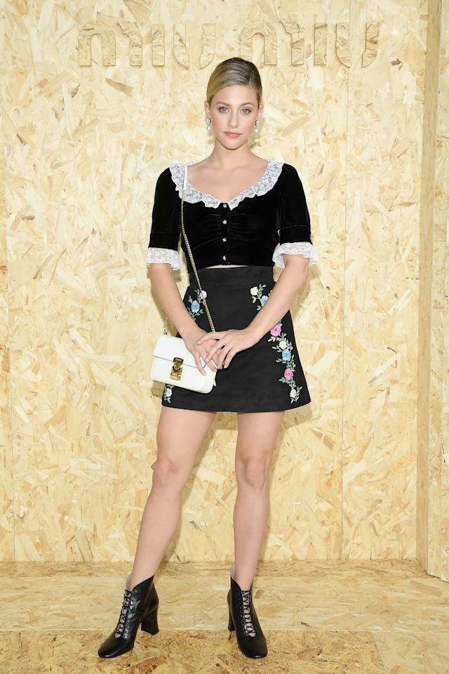 Lili opted for a classic black and white top paired with an embroidered miniskirt and black booties at Paris Fashion Week.