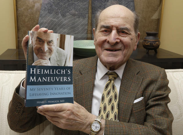 <p>Dr. Henry Heimlich was most famous, of course, for his namesake Heimlich manuever, created to save choking victims. He died December 17 at the age of 96. — (Pictured) Dr. Henry Heimlich holds his memoirs prior to being interviewed at his home in Cincinnati in 2014. (AP Photo/Al Behrman) </p>