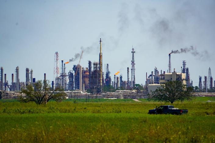 Pollution from refineries near the Mississippi River outside New Orleans lofts into the air.