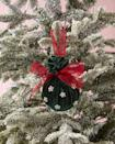 """<p>The perfect sophisticated touch for that friend who favors cultivated over cute, this velvet ornament is sure to be a Christmas hit.</p><p><strong>To make:</strong> Cut a square of velvet fabric. Wrap around a ball ornament, cinching it at the top. Tie a piece of ribbon around the cinch to hold closed and create a hanger. Tie a bow from the same ribbon and attach with hot glue. Attach small pearl craft bead with hot glue.</p><p><a class=""""link rapid-noclick-resp"""" href=""""https://www.amazon.com/Darice-1500-Piece-Round-Pearl-White/dp/B0054G5K0U/ref=sr_1_2?tag=syn-yahoo-20&ascsubtag=%5Bartid%7C10050.g.645%5Bsrc%7Cyahoo-us"""" rel=""""nofollow noopener"""" target=""""_blank"""" data-ylk=""""slk:SHOP SMALL PEARL BEADS"""">SHOP SMALL PEARL BEADS</a></p>"""