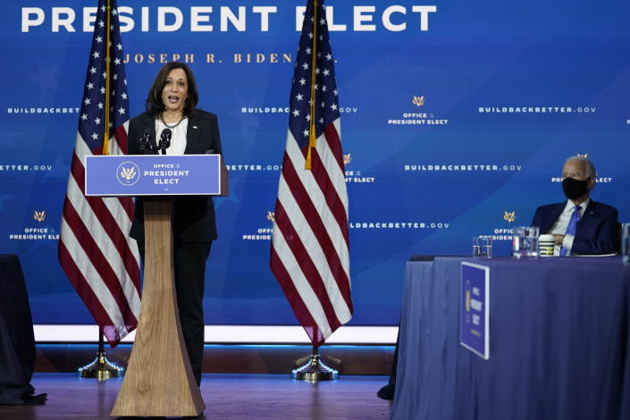 Vice President-elect Kamala Harris speaks as she and President-elect Joe Biden, at right, introduce their nominees and appointees to economic policy posts at The Queen theater, Tuesday, Dec. 1, 2020, in Wilmington, Del. (AP Photo/Andrew Harnik)