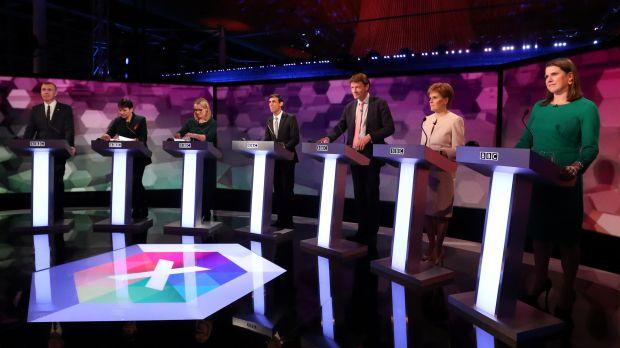 Seven party representatives for the UK general election on stage before a debate.