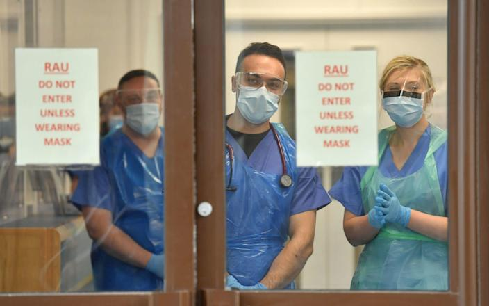 Medical staff wearing personal protective equipment (PPE) - Jacob King/PA Wire