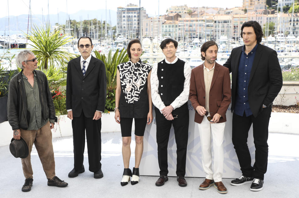 Leos Carax, from left, Ron Mael, Marion Cotillard, Russell Mael, Simon Helberg, and Adam Driver pose for photographers at the photo call for the film Annette at the 74th international film festival, Cannes, southern France, Tuesday, July 6, 2021. (Photo by Vianney Le Caer/Invision/AP)