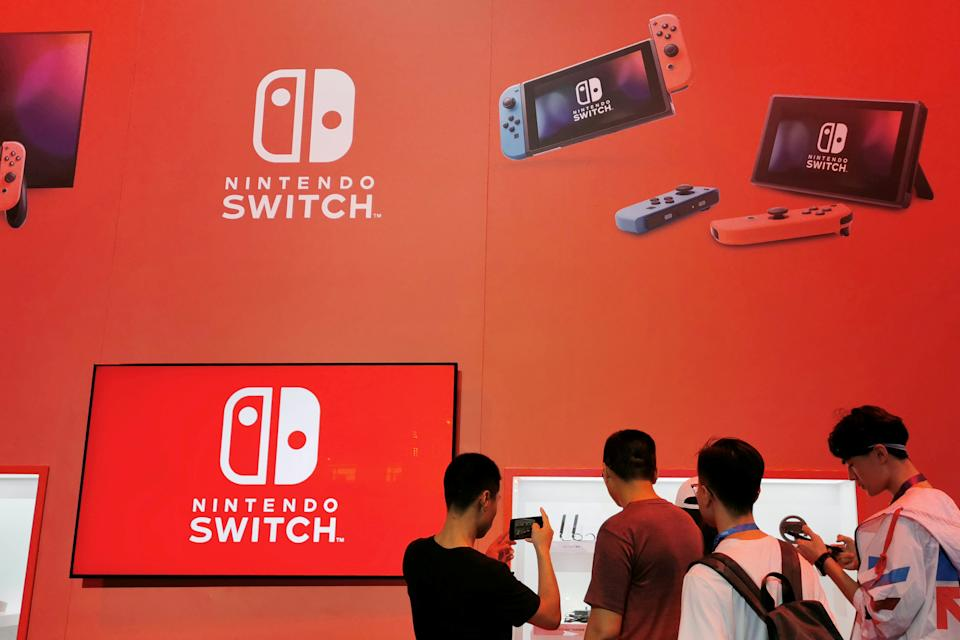 Visitors are seen at a booth of Nintendo Switch at the China Digital Entertainment Expo and Conference, also known as ChinaJoy, in Shanghai, China August 2, 2019.  REUTERS/Pei Li