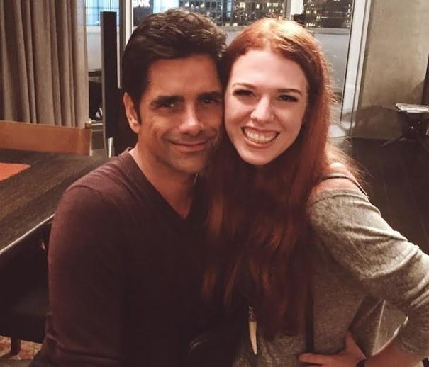 """A fan posing with John Stamos on the set of """"Grandfathered"""""""