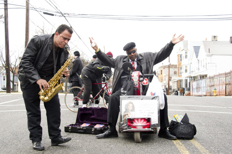 Leriandre Silva, left, plays a Whitney Houston song near the funeral services for Whitney Houston at the New Hope Baptist Church in Newark, N.J., Saturday, Feb. 18, 2012. Houston died last Saturday at the Beverly Hills Hilton in Beverly Hills, Calif., at the age 48. (AP Photo/Charles Sykes)
